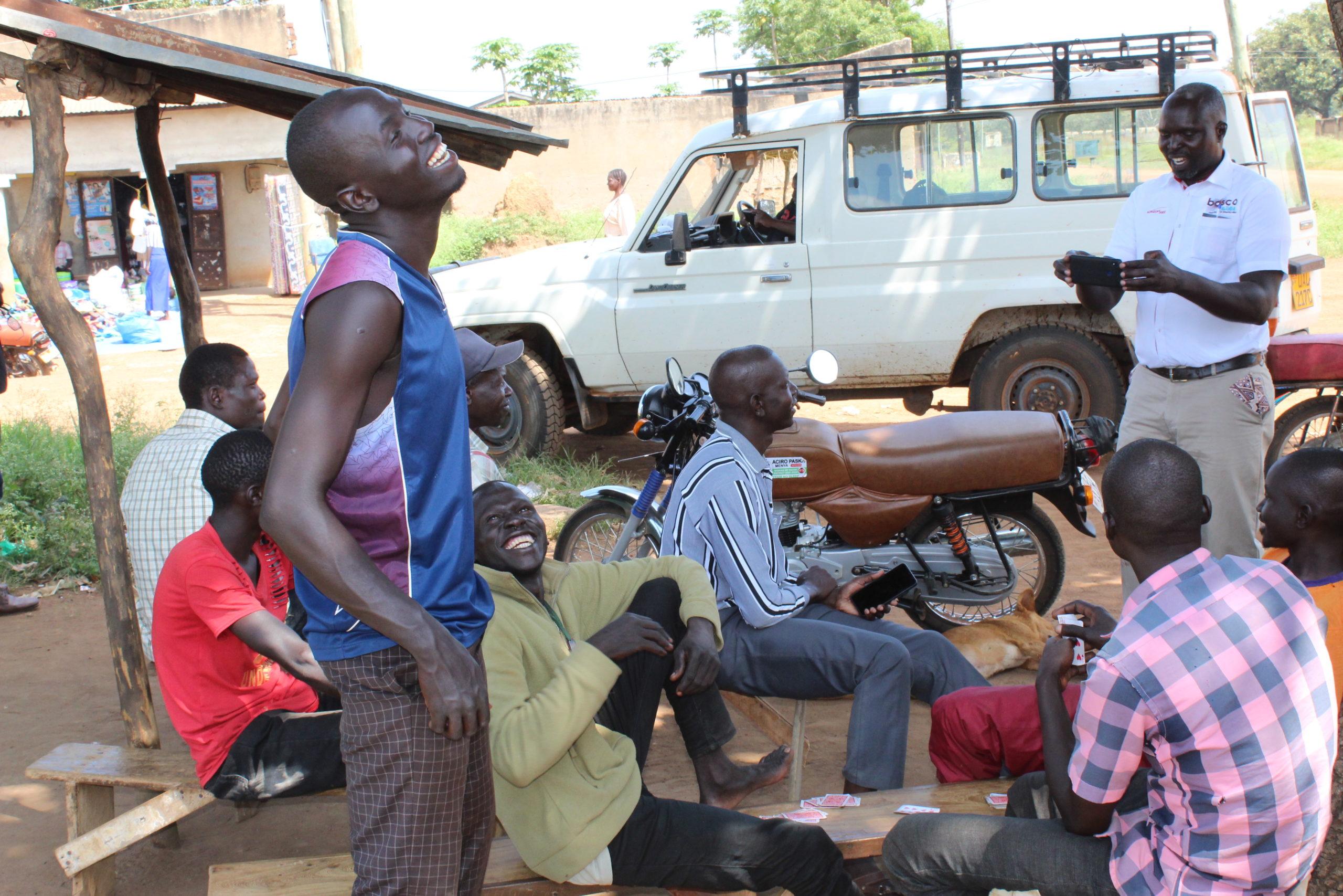 BOSCO Uganda staff enage community members in Rakoko, Pader district