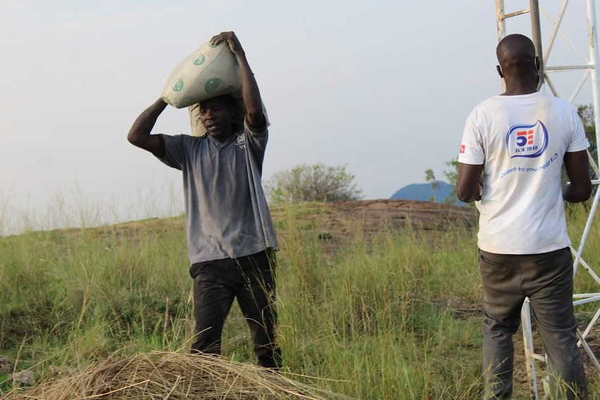 A community member provides manual labour during a recent tower construction in Latanya